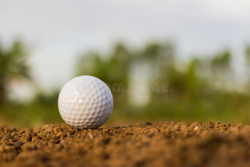 Golf ball on ground. Individual sports stock photo