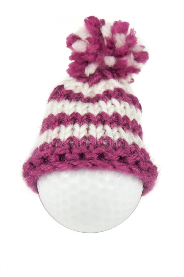 Golf ball with hat royalty free stock image