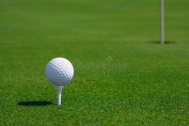 Golf ball and hole. Golf ball in a course and hole More GOLF pictures here royalty free stock photography