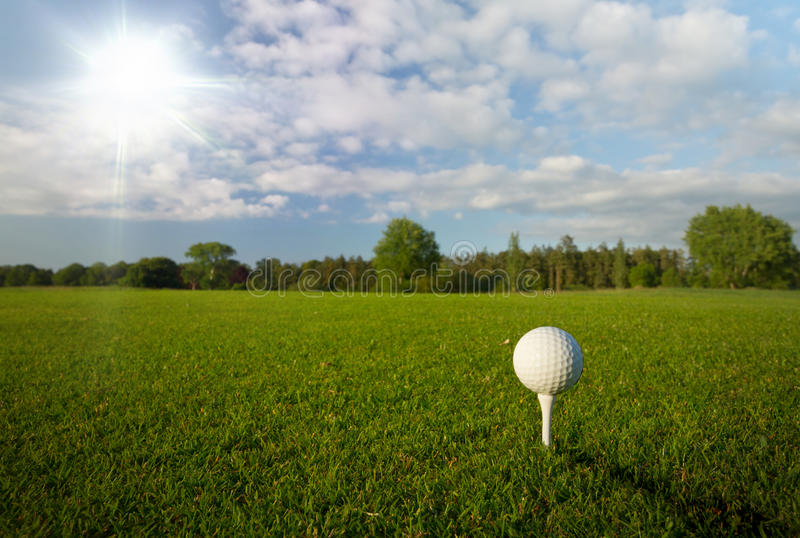 Golf ball in the idyllic scenery royalty free stock photography