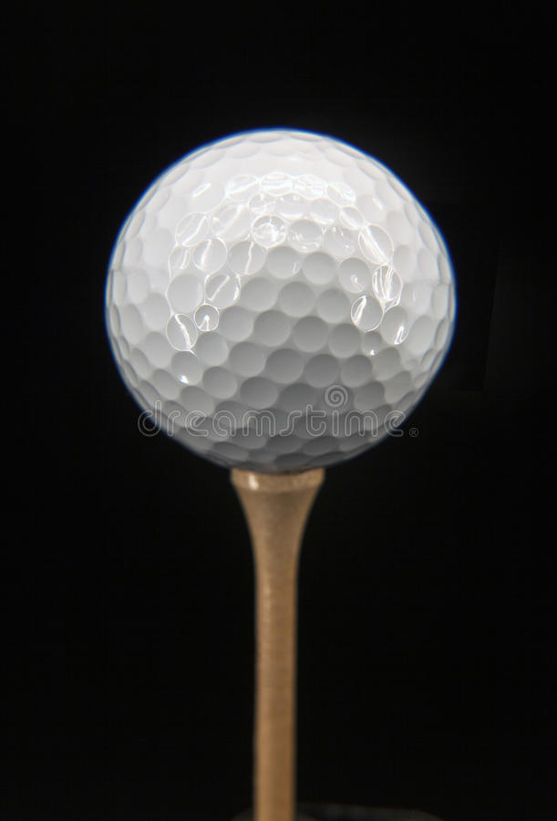 Golf ball. Image is posed on dark background stock photos