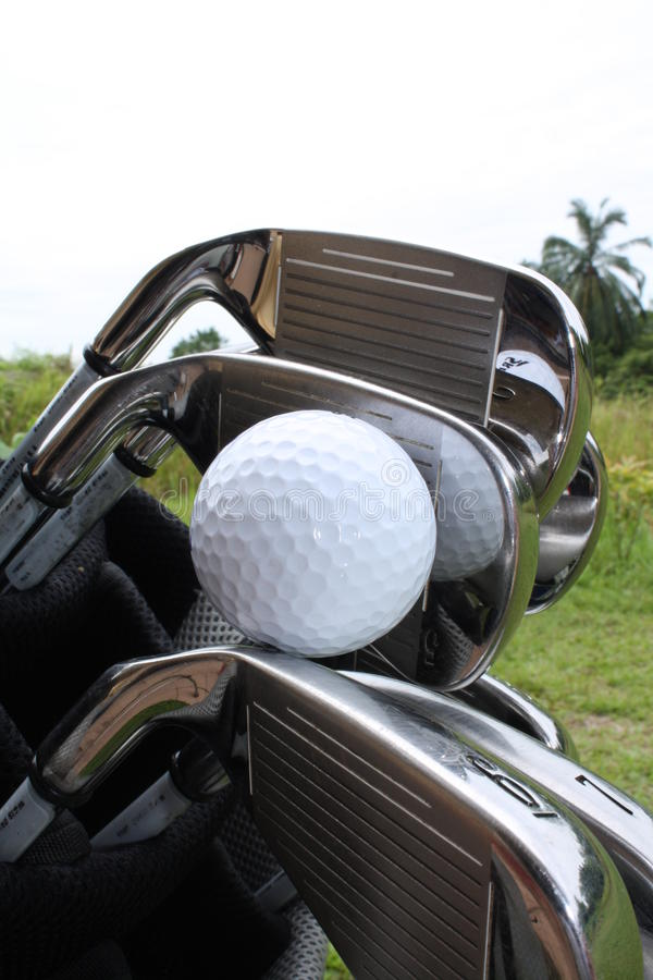Golf ball on the irons royalty free stock images