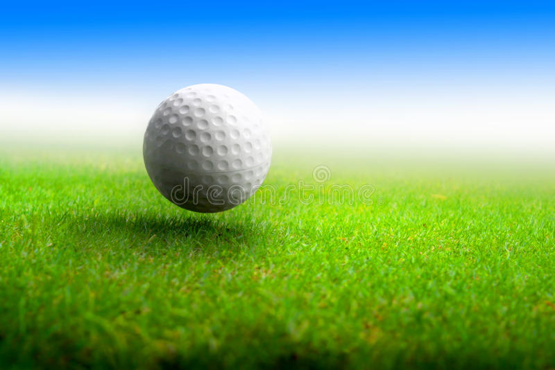 Golf ball on meadow stock photos