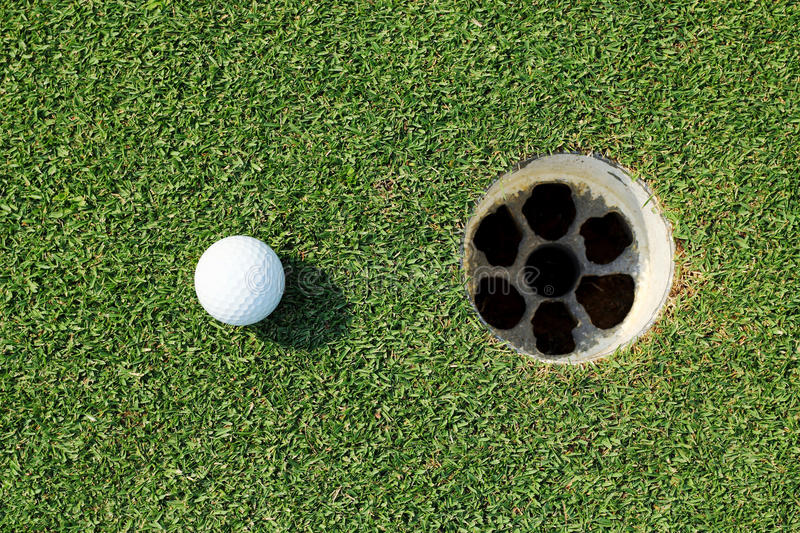 Download Golf ball near the hole stock photo. Image of lifestyle - 39643972