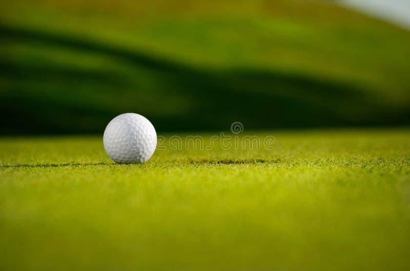 Golf Ball Next To A Hole  stock photo