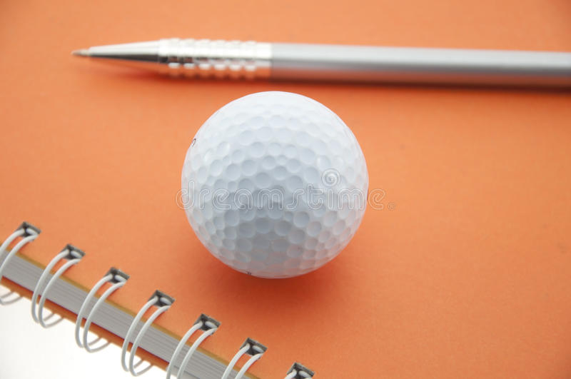 Golf ball and pen stock photo
