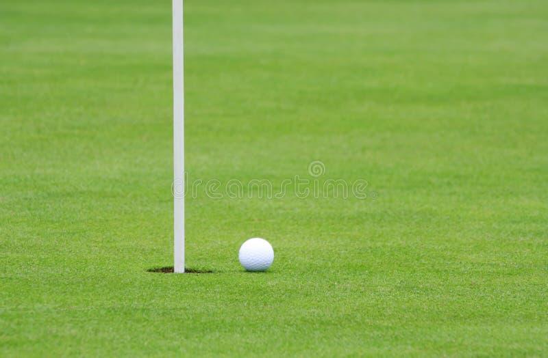 Golf Ball and Pin stock photos