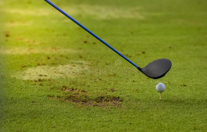 Golf ball putting on sand near hole golf to win in game at golf course with blur background and sunlight ray stock images