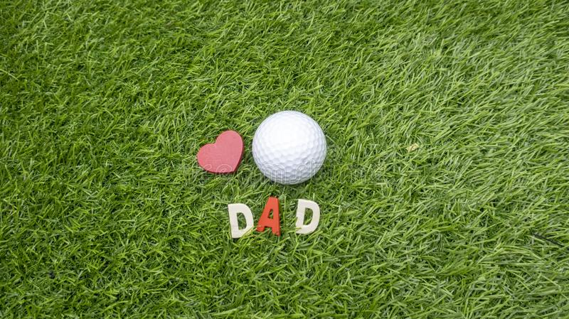 Golf ball with red heart and word DAD royalty free stock images
