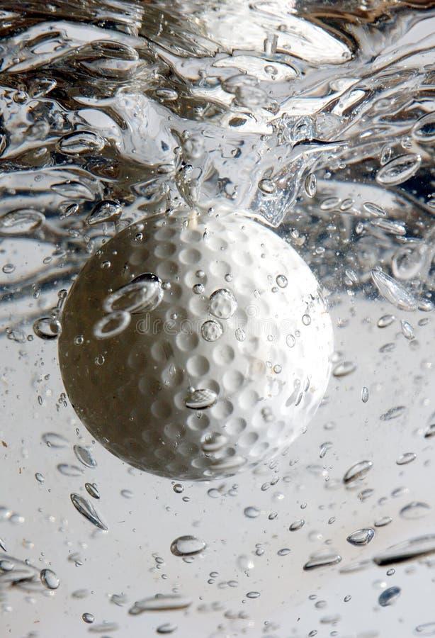 Golf ball splash 2 royalty free stock photo
