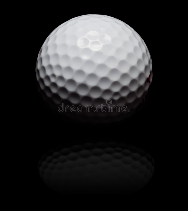 Golf ball in spot on black. Golf ball in spot light on black (with reflexion stock image