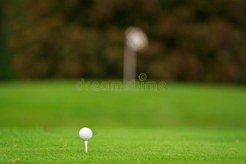 Golf ball on the tee royalty free stock images