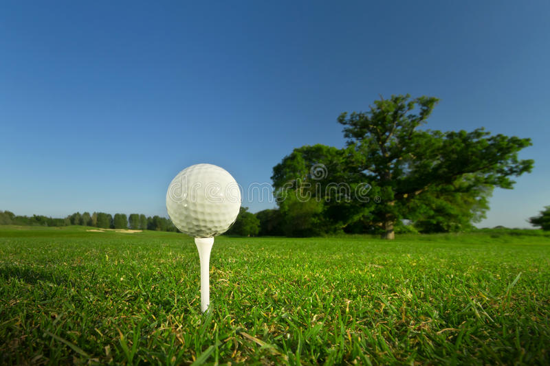 Golf ball on the tee royalty free stock photo