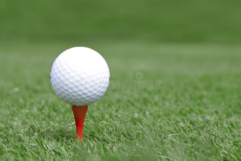 Golf ball on tee royalty free stock photo