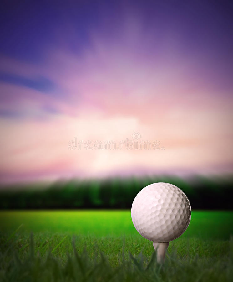 Golf ball on tee. At sunset with copy space royalty free stock photography