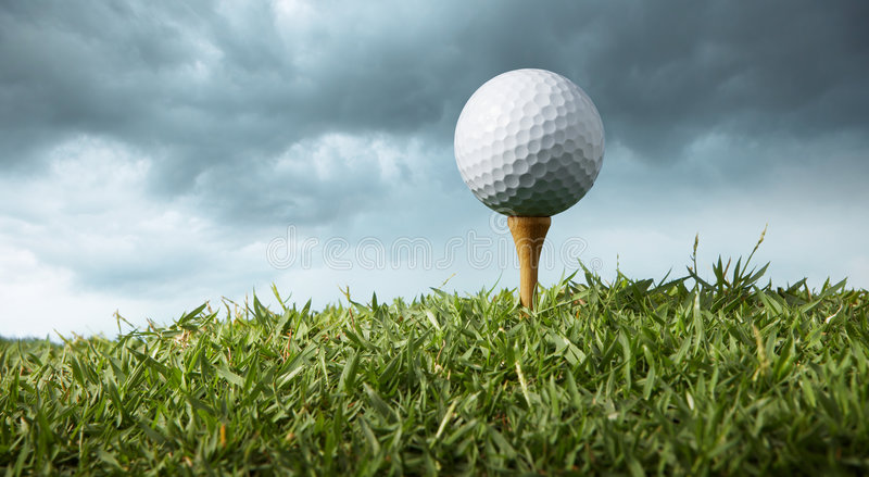 Golf ball on tee royalty free stock photos