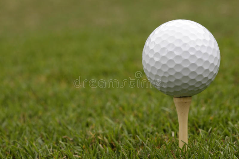 Golf Ball on Tee - Closeup royalty free stock images