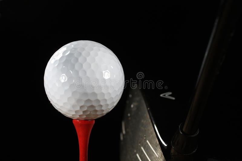 Golf Ball on Tee with Driver royalty free stock photo