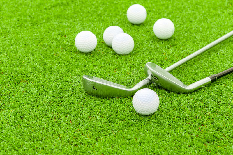 Golf ball on tee in front of driver green course royalty free stock image