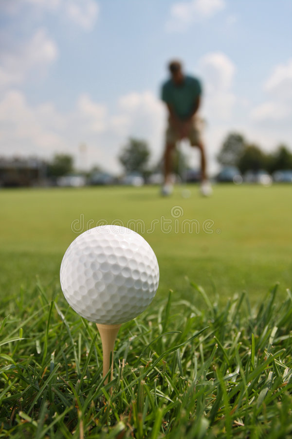 Golf Ball on Tee with Golfer royalty free stock photos