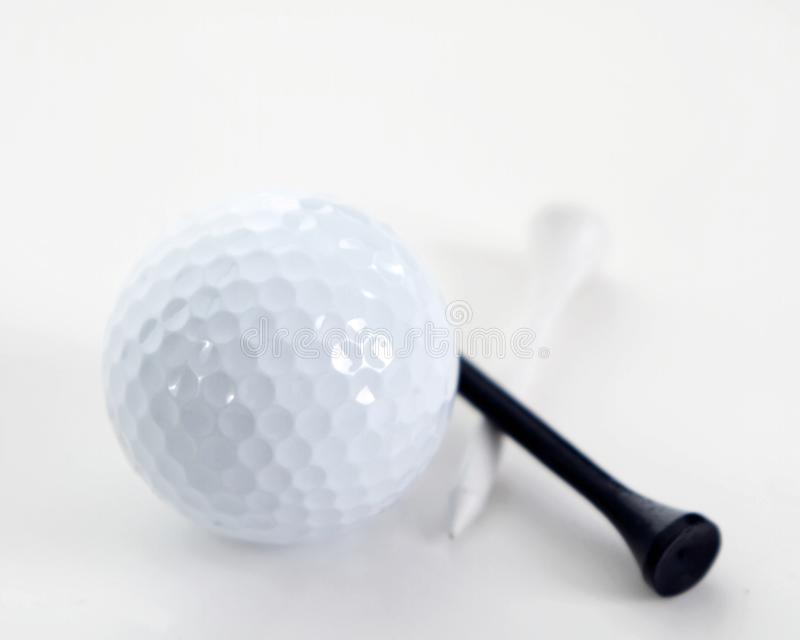 Golf ball and tees on white royalty free stock photography