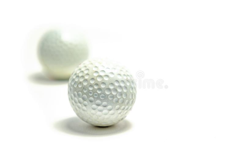 Golf ball on white background royalty free stock photography