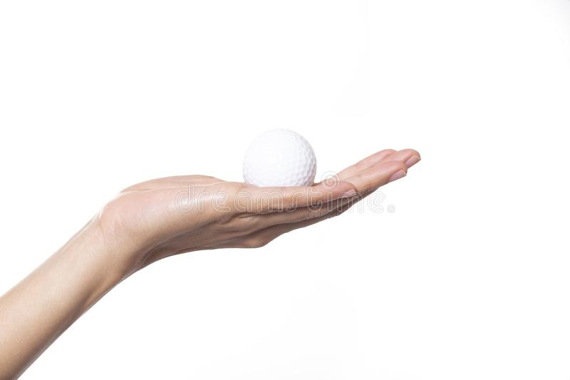 Golf ball in woman hand royalty free stock image
