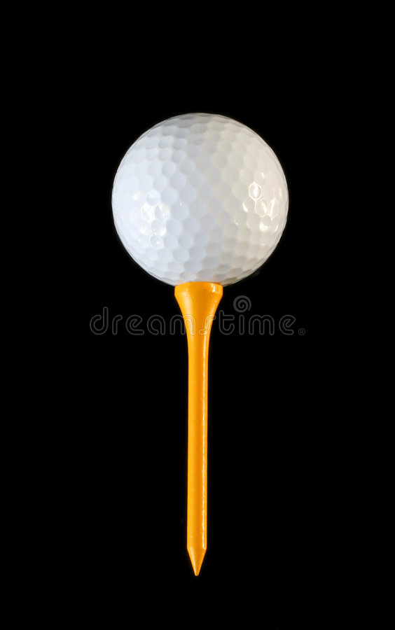 Golf Ball on Yellow Tee stock image