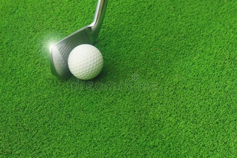 Golf balls and golf clubs on green grass. stock photography