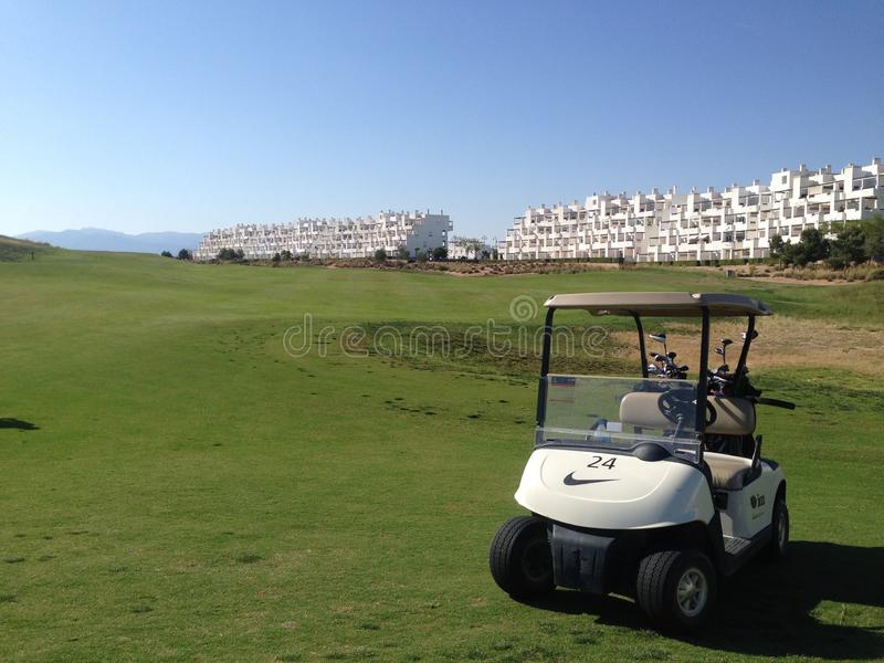 Golf buggy parked on the golf course at Condado de Alhama Golf cource in Costa Calida south Spain royalty free stock photography
