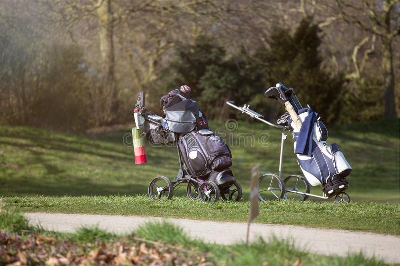 A golf caddy bag. Two golf caddy bags stock photography