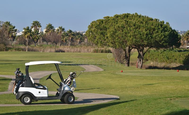 Golf Caddy on the course. A modern electric golf caddy on a great golf course in Portugal stock images