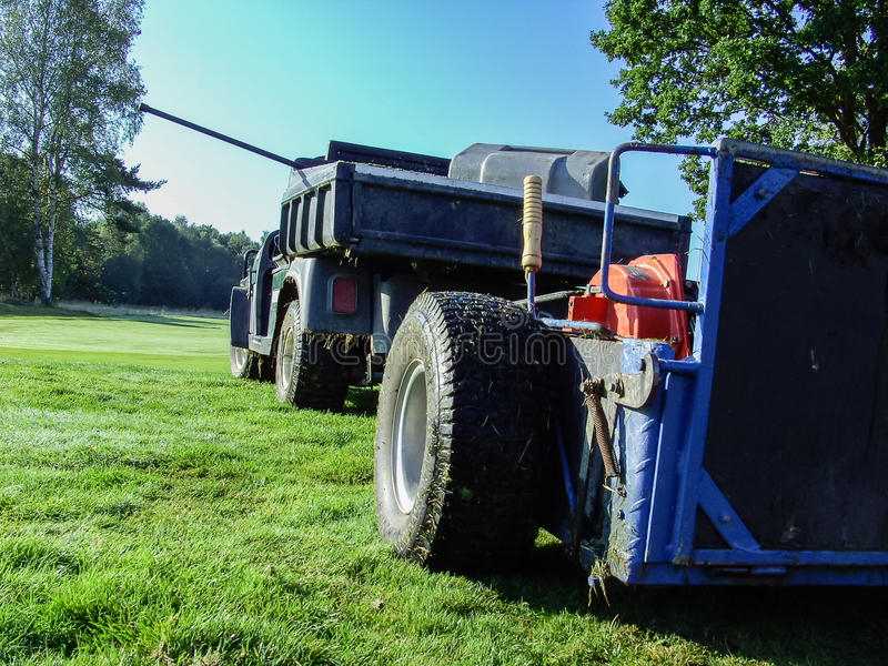 Golf car with lawnmower stock images
