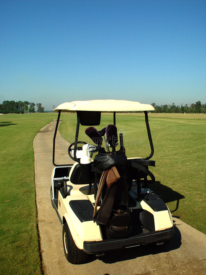 Golf Cart. On the cart path stock photo