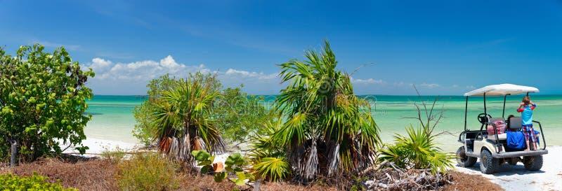 Golf cart at tropical beach stock photo