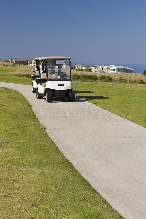 Download Golf Carts On Golf Course Road Stock Image - Image: 32932829
