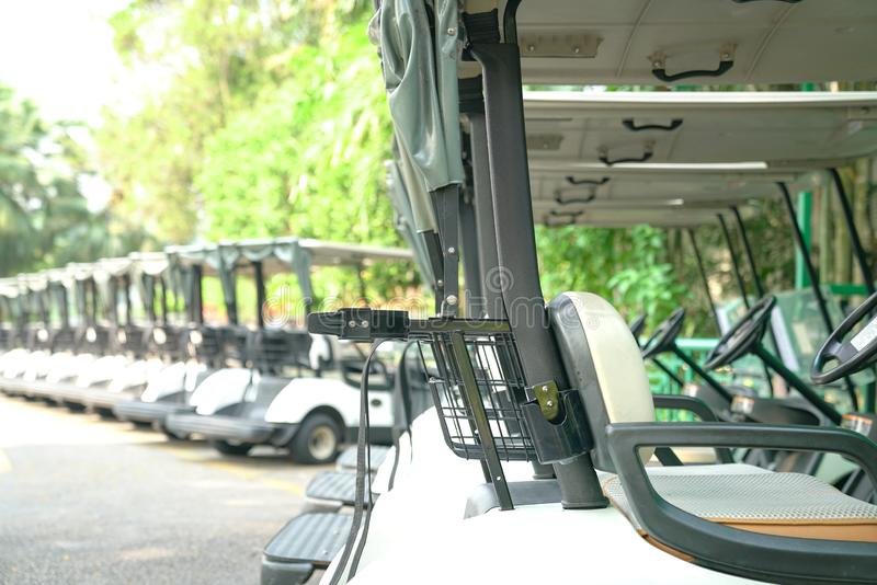 Golf carts parked outdoor. Recreation or transport concept : Golf carts parked outside a golf club stock photo