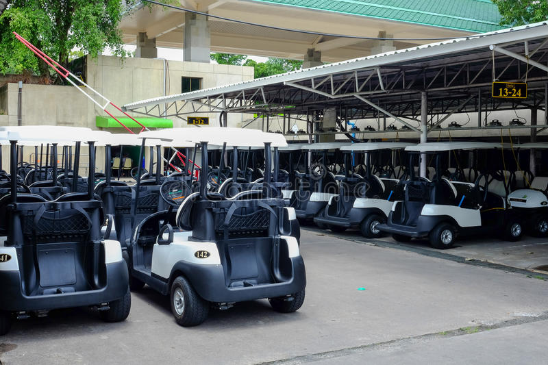 Golf carts parking in the parking area stock photo