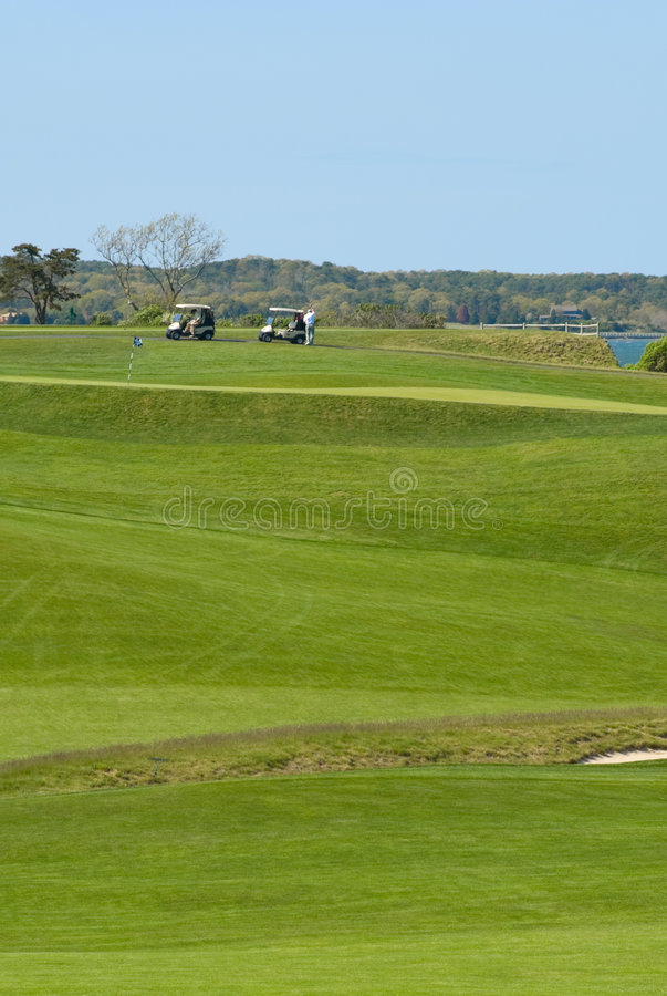 Golf carts and players on course at country club royalty free stock photos