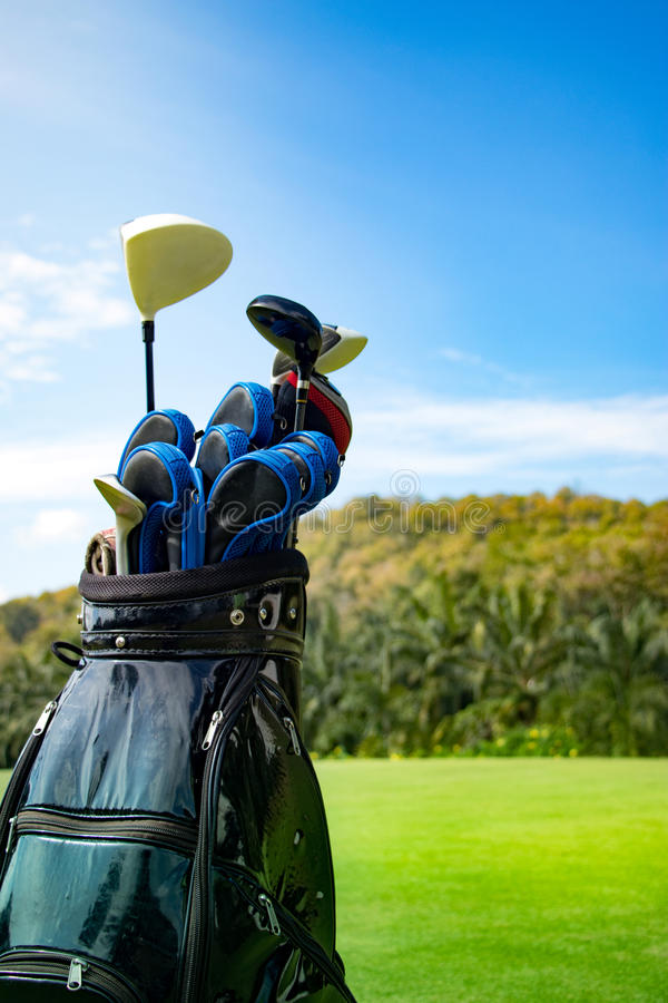 Golf. Club in bag with sky and green royalty free stock image