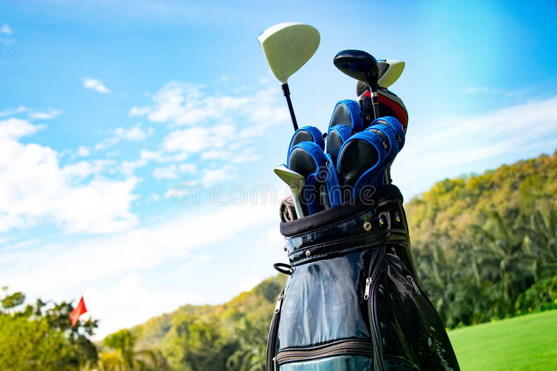 Golf. Club in bag with sky and green royalty free stock photography