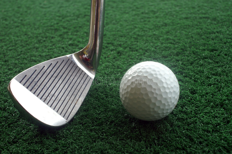Golf club and ball. On green royalty free stock photos