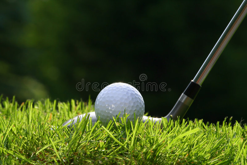 Golf club with ball. On grass stock photos