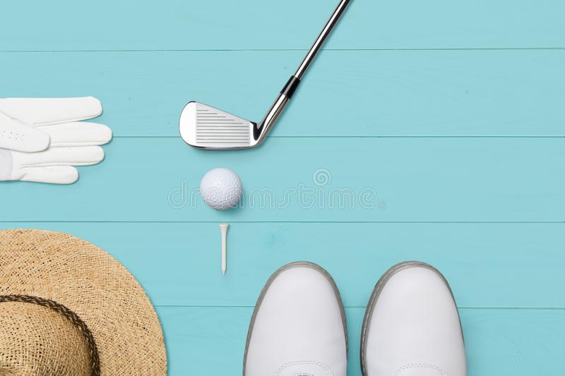 Golf club, golf ball, golf glove and tees on wooden base in blue. From above, free space for text vector illustration