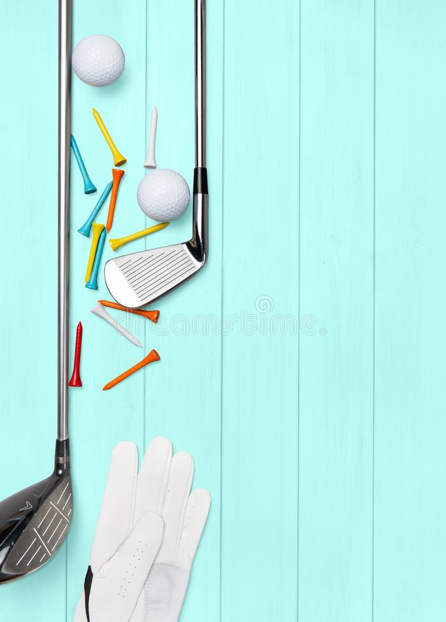 Golf club, golf ball, golf glove and tees on wooden base in turquoise. From above, text space vector illustration