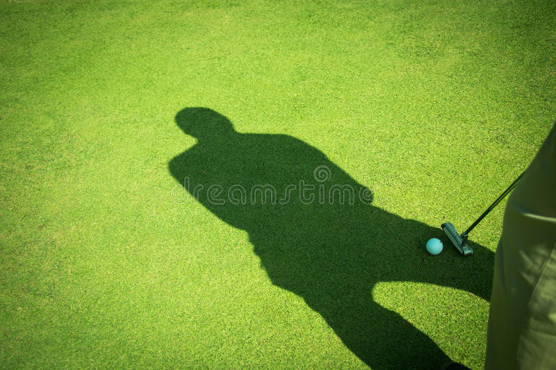 Golf. Club and ball in grass stock photography