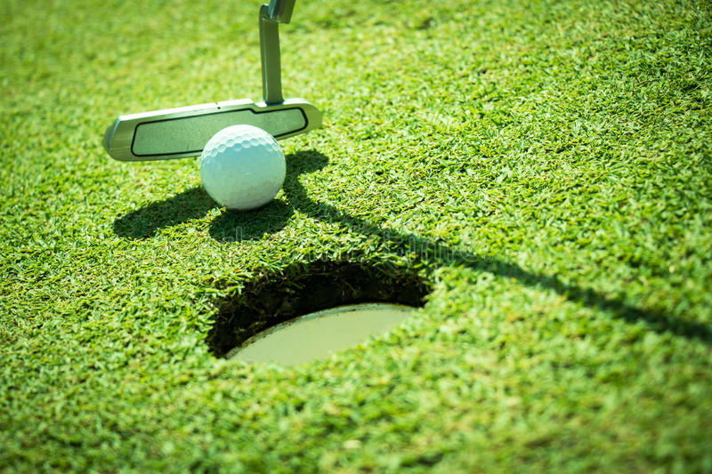 Golf. Club and ball in grass royalty free stock image