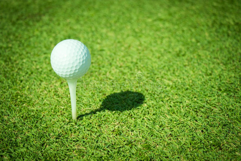 Golf. Club and ball in grass stock images