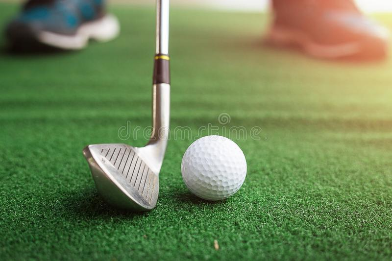 Golf club and ball in green grass. Golf club and ball in green grass royalty free stock images