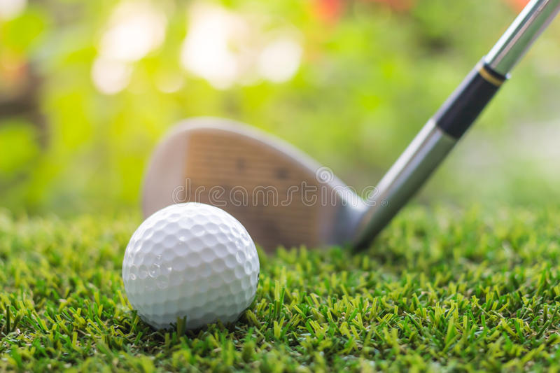 Golf club and ball on green grass. Individual sports royalty free stock photo